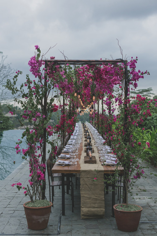 bougainvillea reception decor - photo by Jonas Peterson http://ruffledblog.com/exotic-garden-party-wedding-in-bali