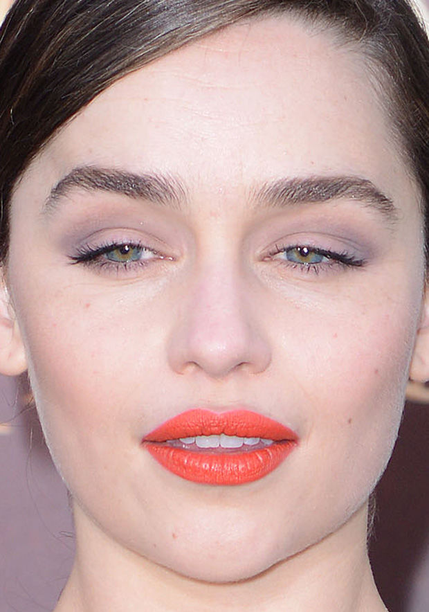 Emilia Clarke's orange lips paired with grey eyeshadow.