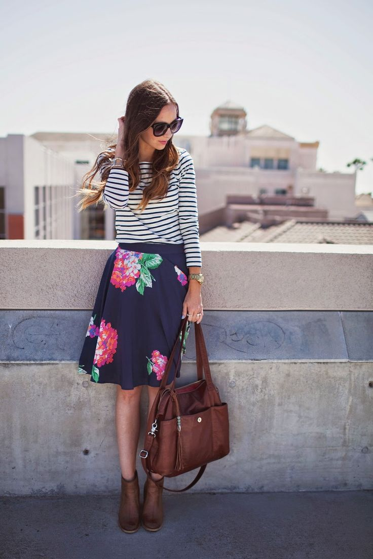 floral skirt and striped top Mix Print Combos to Wear this Spring