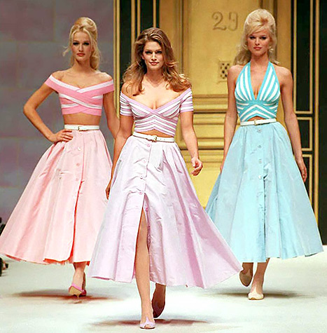 Karen Mulder, Cindy Crawford and Eva Herzigova wear criss-crossed striped tops over wide, front buttoned dresses in pastel for Herve Leger's Spring-Summer 1996 ready-to-wear collection presented in Paris.
