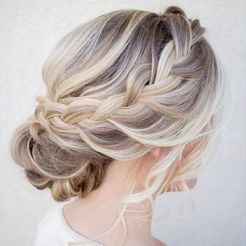 Side French Braid into a Low Bun