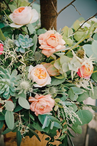 Peach flowers and succulents | Irinia Kilmova Photography | see more on: http://burnettsboards.com/2015/03/winter-forest-wedding/