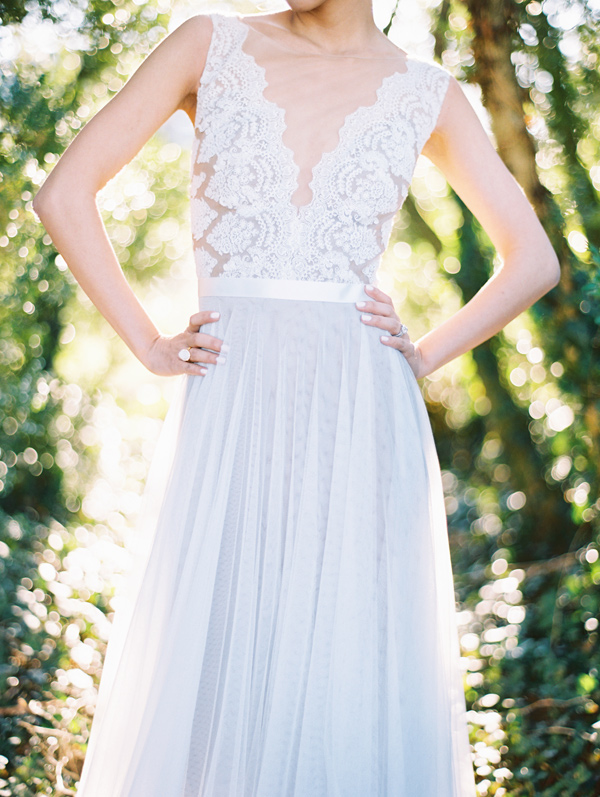 lace wedding dress with illusion neckline - photo by Adam Barnes http://ruffledblog.com/organic-greenhouse-wedding-inspiration