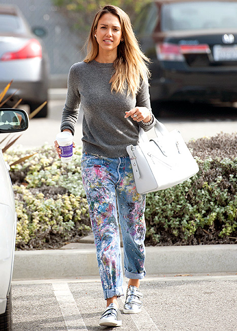 Jessica Alba models artfully paint-splattered jeans while out and about in L.A. on Feb. 20.