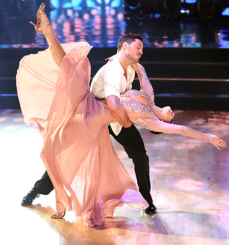 How low can she go? Val Chmerkovskiy dips Rumer Willis on the dance floor at the Dancing With the Stars premiere on March 16.