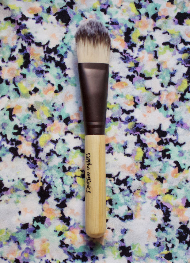 The Sappho Organics Foundation Brush features a sustainable bamboo handle.