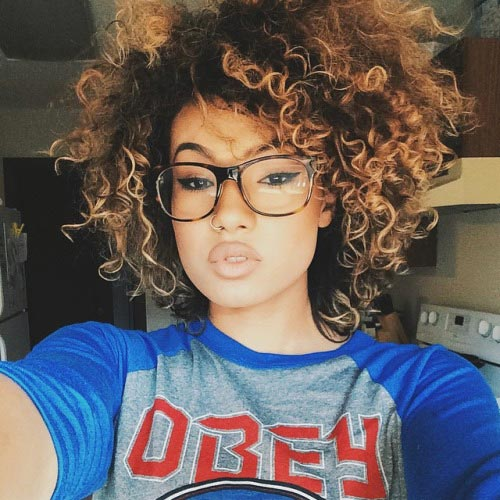 Natural Curly Hairstyle with Highlights