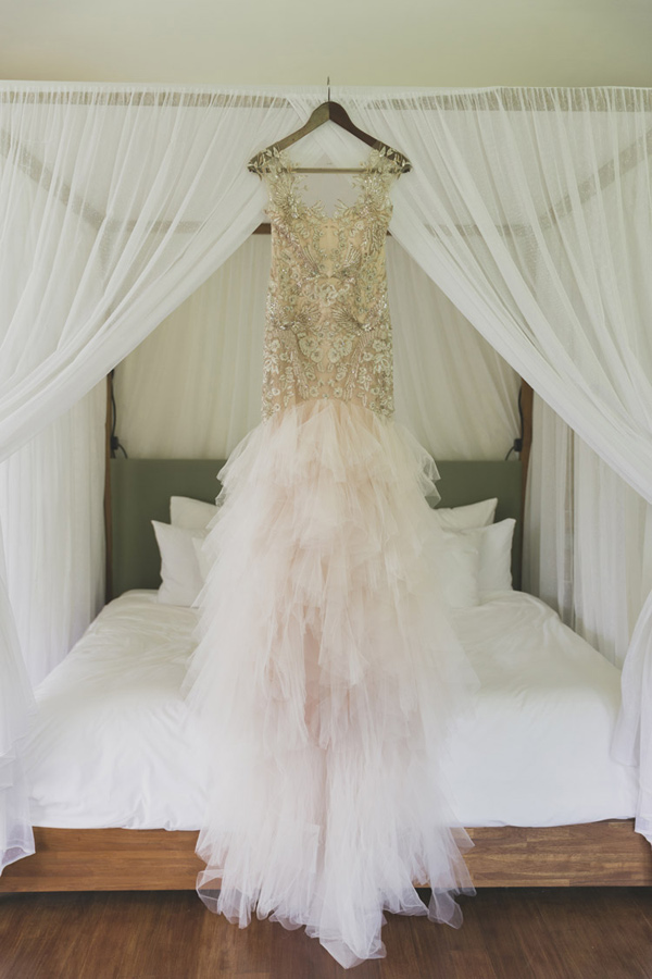 beaded wedding dress - photo by Jonas Peterson http://ruffledblog.com/exotic-garden-party-wedding-in-bali