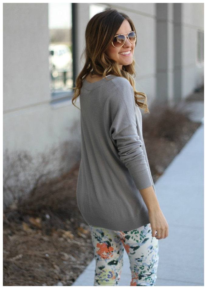 floral pants and gray sweater