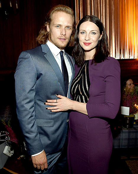 Costars and on-screen lovers Sam Heughan and Caitriona Balfe sizzle at the Outlander mid-season premiere afterparty at The Oak Room in NYC on April 1.