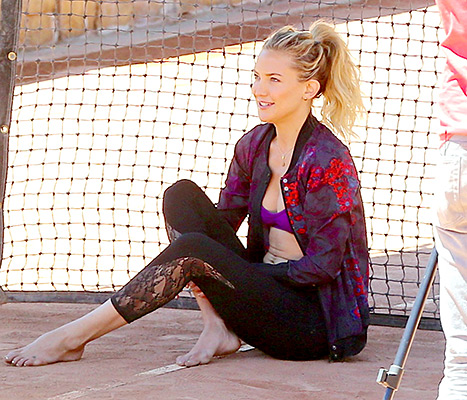 Kate Hudson models a printed jacket, purple sports bra, and lace leggings on the set of a Fabletics photo shoot in L.A. on April 28.