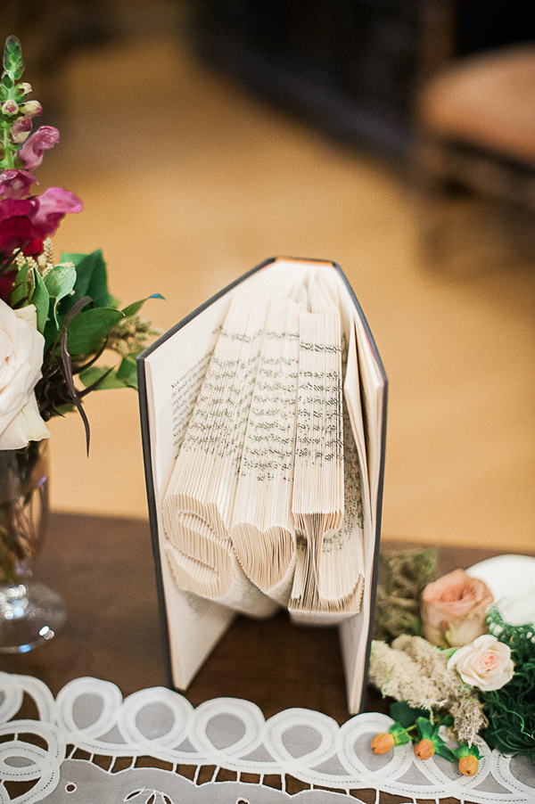 folded book page decoration - photo by Brandi Welles Photographer http://ruffledblog.com/sheer-romance-wedding-at-carondelet-house