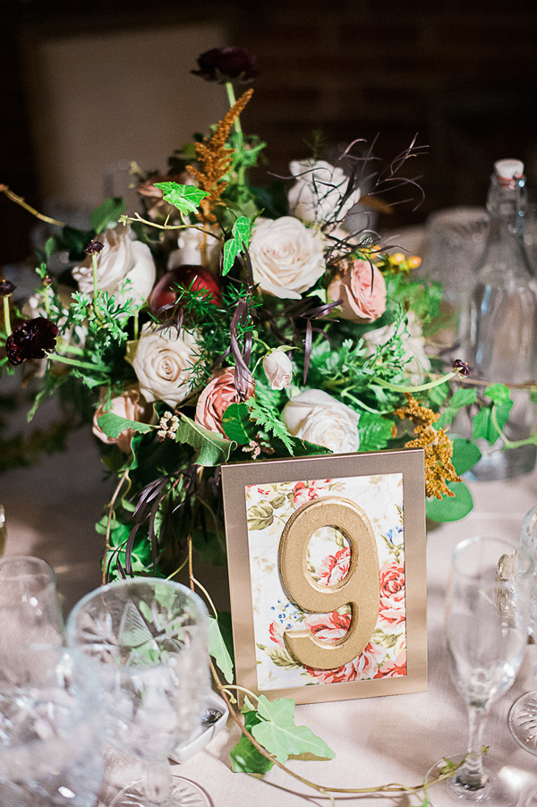 floral and gold table number - photo by Brandi Welles Photographer http://ruffledblog.com/sheer-romance-wedding-at-carondelet-house