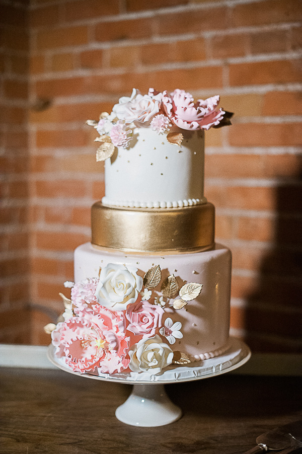 pink wedding cake - photo by Brandi Welles Photographer http://ruffledblog.com/sheer-romance-wedding-at-carondelet-house