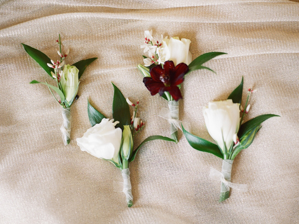 groom boutonnieres - photo by JD3 Photography http://ruffledblog.com/party-city-wedding-in-atlanta