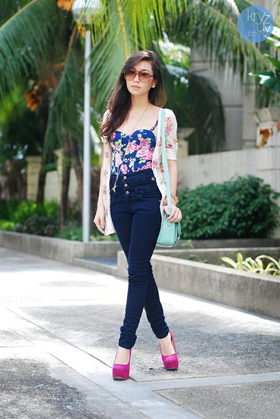corset top and high waisted jeans