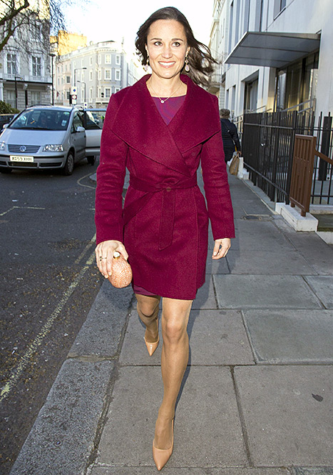 En route to the Spectator Life bash in London, Pippa Middlelton modeled a plum-hued wrap coat.
