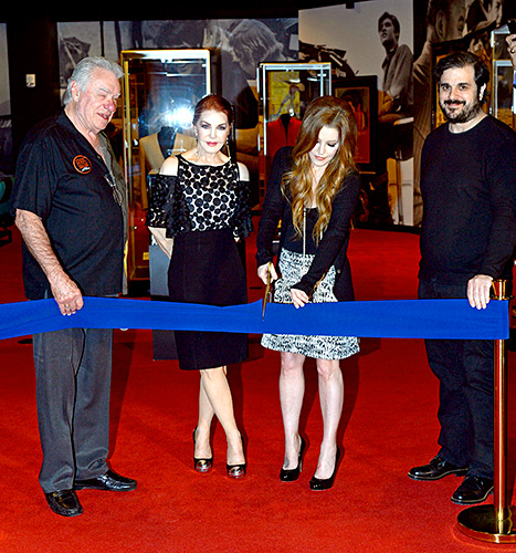 Priscilla Presley and Lisa Marie snip the blue ribbon to officially open
