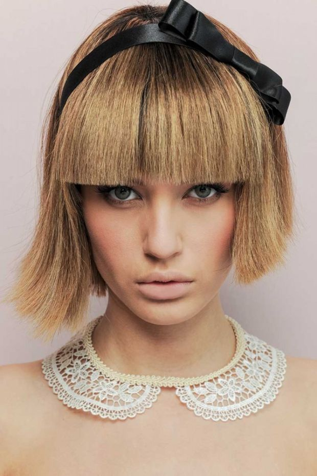 Uneven bob haircut with bangs.