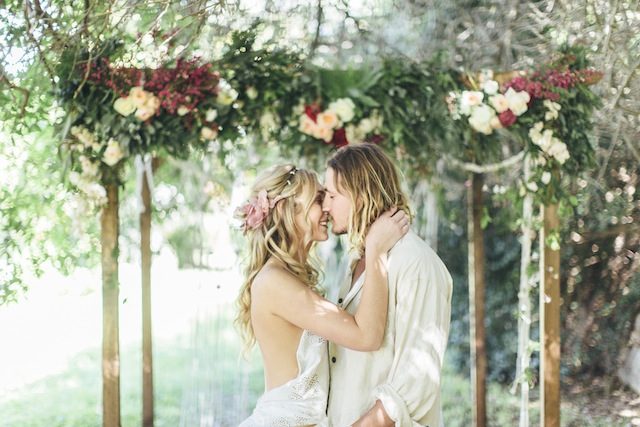 Flower covered wedding ceremony arch ⎪ Tina Shawal Photography ⎪ see more on: http://burnettsboards.com/2015/04/island-inspired-bohemian-wedding/