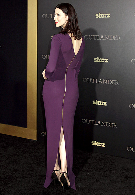 Caitriona Balfe works the zippered back of her sexy Roland Mouret dress at the NYC mid-season premiere of Outlander on April 1.
