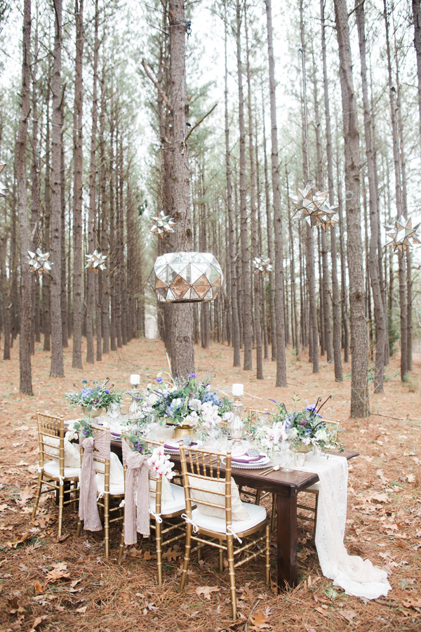 glam reception in the woods - photo by Jen and Chris Creed http://ruffledblog.com/purple-and-ivory-wedding-in-the-woods