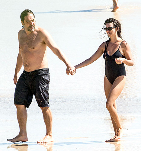 Javier Bardem and Penelope Cruz hold hands at the beach while on vacation in Bryon Bay, Australia.