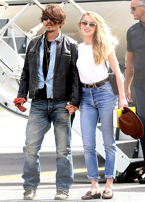 Johnny Depp and Amber Heard arrive at Brisbane Airport, Australia on April 21, 2015.