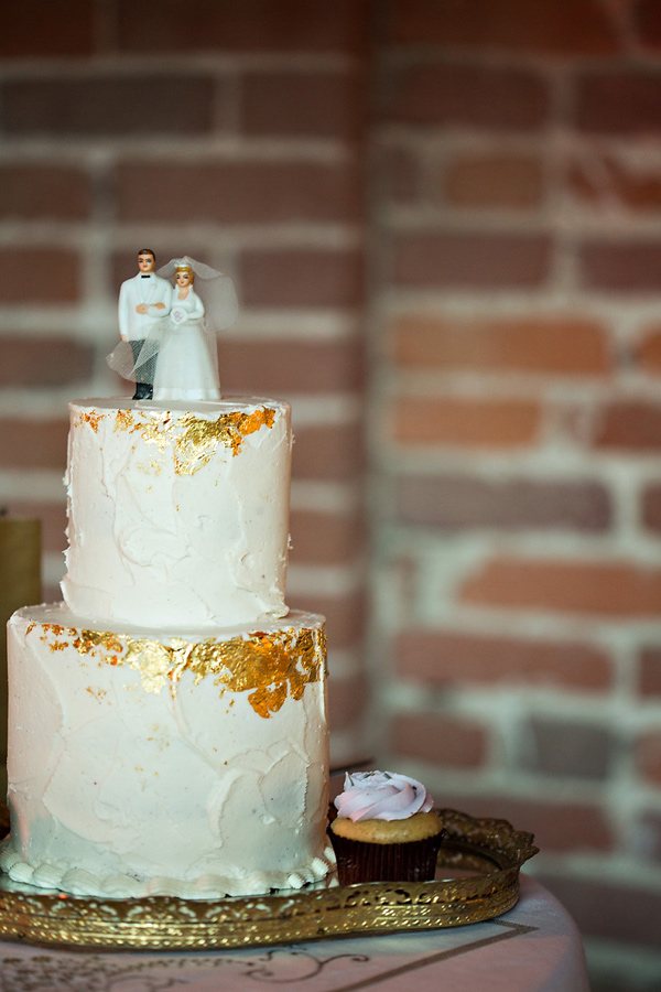 gold flake wedding cake - photo: You & Me Photography - http://ruffledblog.com/wanderlust-inspired-wedding-in-los-angeles