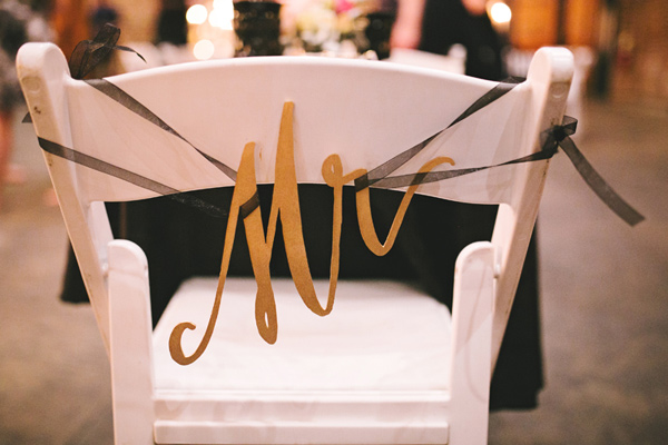 chair back signs - photo by Emily Chidester http://ruffledblog.com/southern-wedding-with-a-gold-sequin-gown