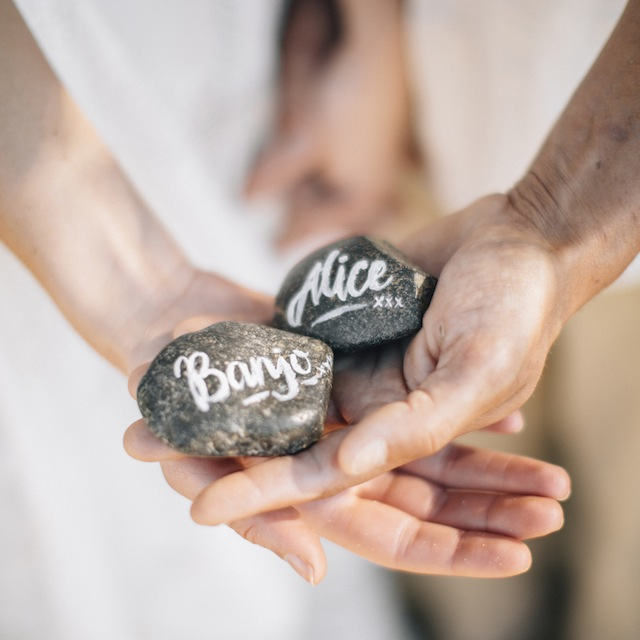 Rock escort cards with calligraphy ⎪ Tina Shawal Photography ⎪ see more on: http://burnettsboards.com/2015/04/island-inspired-bohemian-wedding/