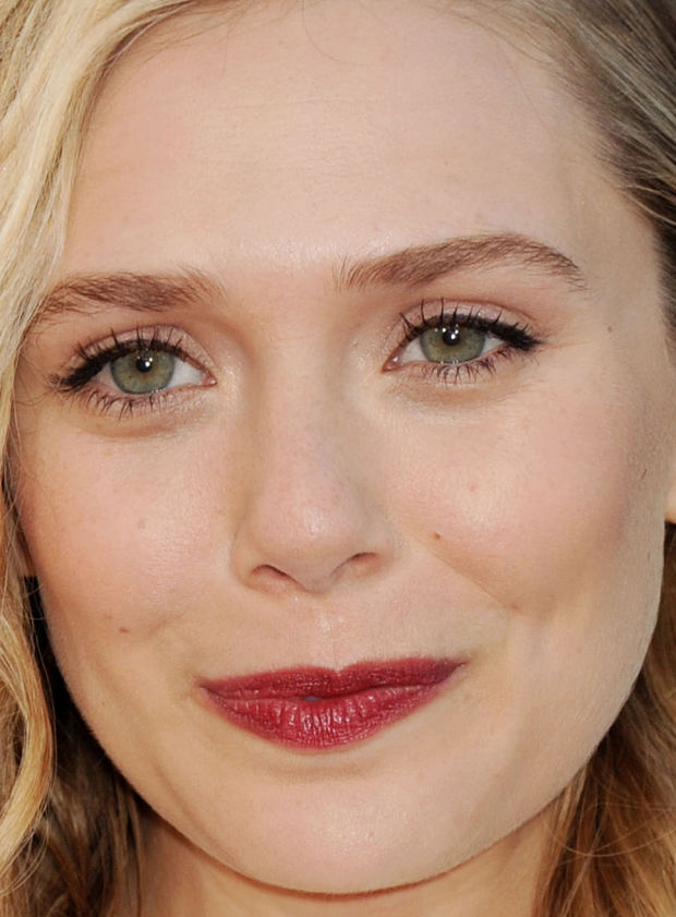 Elizabeth Olsen's flawless skin, berry lips and black liner.