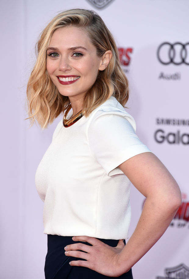 Elizabeth Olsen pairs berry lips with bare nails.