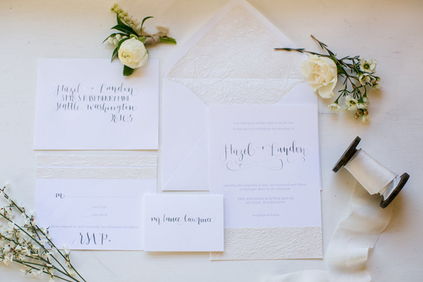 white wedding invitations - photo by Kelly Lemon Photography http://ruffledblog.com/monochrome-spring-wedding-editorial