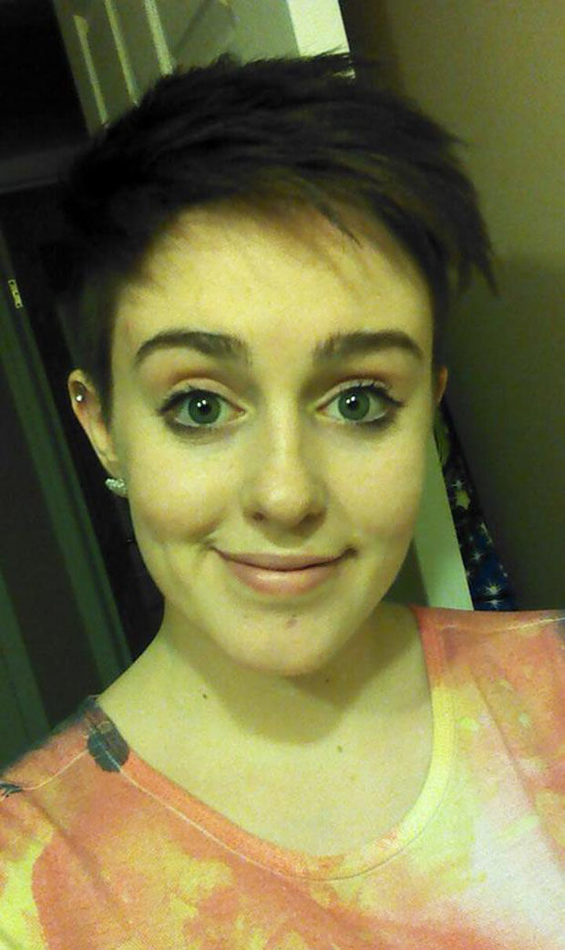 Gina is growing out this pixie cut.