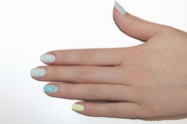 Apply JINsoon Nail Lacquer in Poppy Blue on the ring finger.
