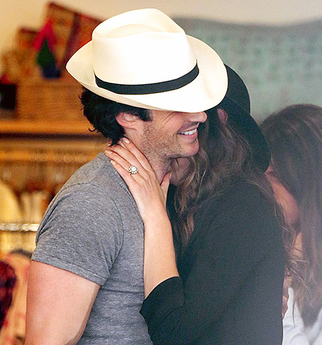 Nikki Reed flashes her floral-inspired halo diamond engagement ring from Ian Somerhalder while the two stroll through Venice on April 6.