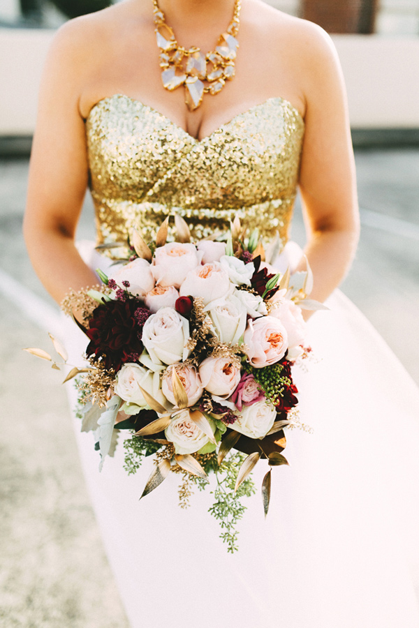rose bouquet with black dahlias - photo by Emily Chidester http://ruffledblog.com/southern-wedding-with-a-gold-sequin-gown