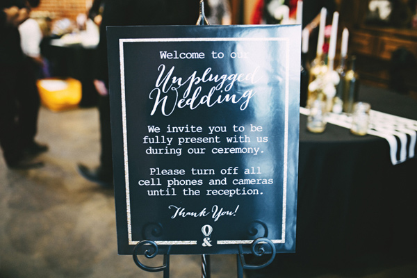 unplugged ceremony sign - photo by Emily Chidester http://ruffledblog.com/southern-wedding-with-a-gold-sequin-gown