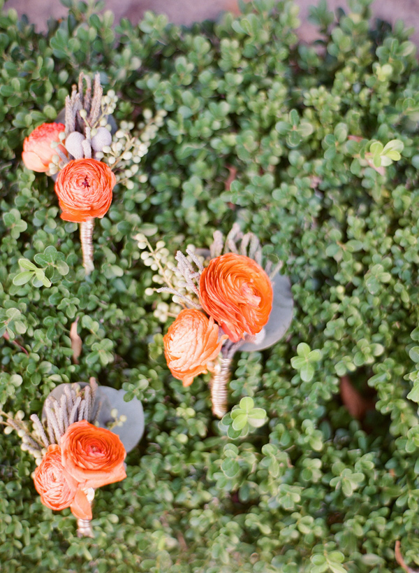 orange ranunculus boutonniere - photo by Shannon Duggan Photography http://ruffledblog.com/propel-workshop-shoot-with-a-handpainted-gown