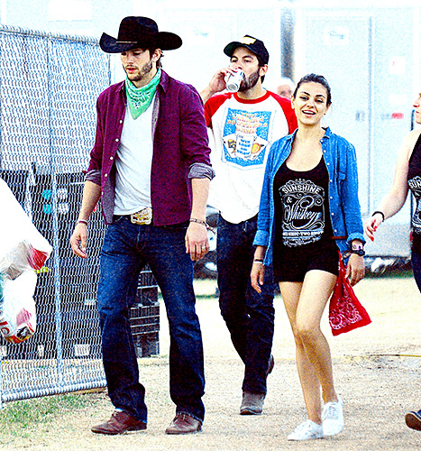Engaged couple Ashton Kutcher and Mila Kunis strolled the grounds in country styles at the Stagecoach Country Music Festival 2015 in Indio, Calif.