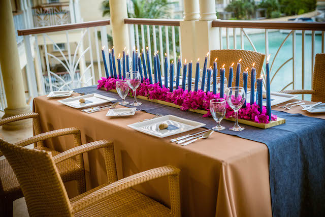 Candle centerpiece | Daniel Marcion of La Belle Porte at The Landings St. Lucia | see more on: http://burnettsboards.com/2015/04/caribbean-vow-renewal/