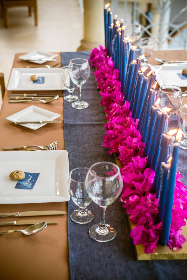 Candle and bougainvillea centerpiece | Daniel Marcion of La Belle Porte at The Landings St. Lucia | see more on: http://burnettsboards.com/2015/04/caribbean-vow-renewal/
