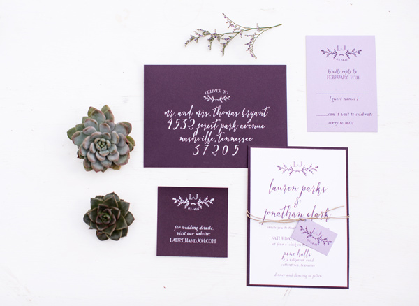purple wedding invitations - photo by Jen and Chris Creed http://ruffledblog.com/purple-and-ivory-wedding-in-the-woods