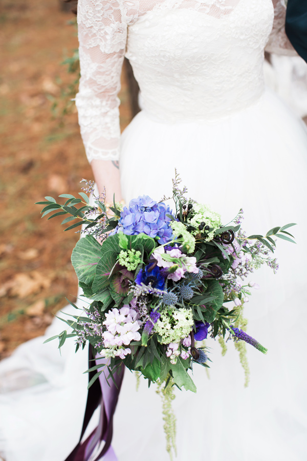 purple and blue bouquet - photo by Jen and Chris Creed http://ruffledblog.com/purple-and-ivory-wedding-in-the-woods