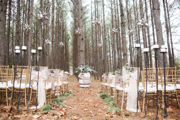 wedding ceremony setup - photo by Jen and Chris Creed http://ruffledblog.com/purple-and-ivory-wedding-in-the-woods