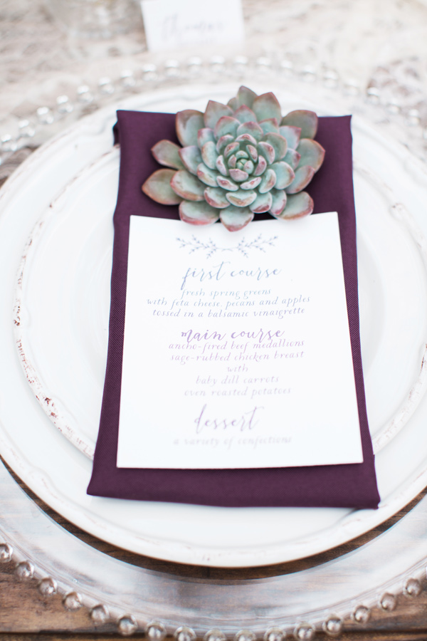 purple place setting with succulents - photo by Jen and Chris Creed http://ruffledblog.com/purple-and-ivory-wedding-in-the-woods