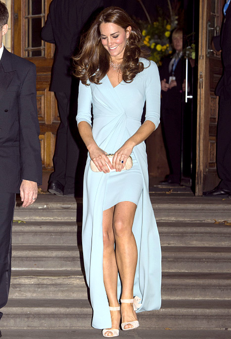 Kate Middleton flaunts her long legs in a high-low dress while leaving the Natural History Museum in London on Oct. 21.