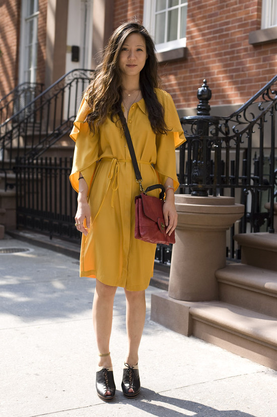 yellow dress and brown bag