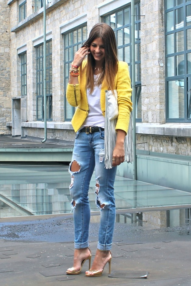 yellow blazer and ripped jeans